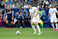CARSON, CA - JUNE 19: Sacha Kljestan #16 of the Los Angeles Galaxy turns with the ball during a game between Seattle Sounders FC and Los Angeles Galaxy at Dignity Health Sports Park on June 19, 2021 in Carson, California.