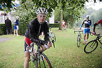 Kevin Pauwels (BEL/Sunweb-Napoleon Games) hiding for the rain underneath a tree before the start<br /> <br /> Belgian Championships 2014 - Wielsbeke<br /> Elite Men