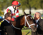 March 29, 2014: on Louisiana Derby Day at the Fairgrounds Race Course in New Orleans, LA. Mary M. Meek/ESW/CSM; Rosie Naprvanik on Vicar's In Trouble greet owner Ken Ramsey after winning the Louisiana Derby.
