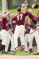 Mickey Wiswall #17 of the Boston College Eagles bashes forearms with a teammate following his solo home run in the top of the 4th inning against the Virginia Tech Hokies at English Stadium May 2, 2010, in Blacksburg, Virginia.  Photo by Brian Westerholt / Four Seam Images