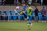 SAN JOSE, CA - MAY 12: Marcos Lopez #27 of the San Jose Earthquakes challenges Alex Roldan #16 of the Seattle Sounders for the ball during a game between San Jose Earthquakes and Seattle Sounders FC at PayPal Park on May 12, 2021 in San Jose, California.
