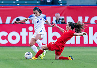 CARSON, CA - FEBRUARY 07: Melissa Herrera #7 of Costa Rica is tackled by Allysha Chapman #2 of Canada during a game between Canada and Costa Rica at Dignity Health Sports Park on February 07, 2020 in Carson, California.
