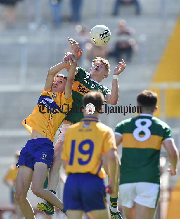 Emmet McMahon of Clare in action against Darragh Lyne of Kerry during their Munster Minor football final at Pairc Ui Chaoimh. Half time score, Clare1-02, Kerry, 1-15 Photograph by John Kelly.