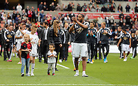 SWANSEA, WALES - MAY 17: Ashley Williams of Swansea leads team mates and staff to thank home supporters after the Premier League match between Swansea City and Manchester City at The Liberty Stadium on May 17, 2015 in Swansea, Wales. (photo by Athena Pictures/Getty Images)