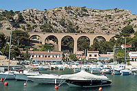 Arched bridge overlooking the port at Ensues-la-Redonne, Provence, France.