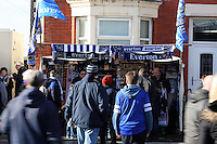Pictured: A stall selling Everton flags and scarves on Goodison Road outside the stadium. Sunday 16 February 2014<br /> Re: FA Cup, Everton v Swansea City FC at Goodison Park, Liverpool, UK.