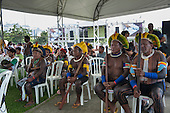 A group of Kayapo indigenous warriors are watching a presentation by another indigenous group at the People's Summit, United Nations Conference on Sustainable Development (Rio+20), Rio de Janeiro, Brazil, 15th June 2012. Photo © Sue Cunningham.