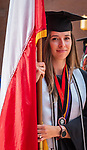 WATERBURY, CT 072421JS11  Graduate Paulina Okon carries the national flag of Poland as they march to the Palace Theater in Waterbury for graduation ceremonies held Saturday. This was a commencement for both 2020 and 2021 graduates. Okon graduated with a Bachelor of Science in Human Resource Management. <br /> Jim Shannon Republican American