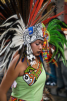 A MEXICAN beauty in AZTEC INDIAN COSTUME & FEATHERED HEADDRESS participates in the FESTIVAL DE SAN MIGUEL ARCHANGEL PARADE - SAN MIGUEL DE ALLENDE, MEXICO