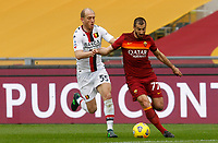 Roma's Henrikh Mkhitaryan, right, is challenged by Genoa's Andrea Masiello during the Italian Serie A Football match between Roma and Genoa at Rome's Olympic stadium, March 7, 2021.<br /> UPDATE IMAGES PRESS/Riccardo De Luca