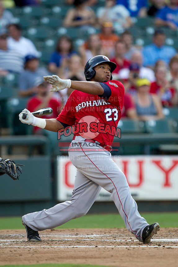 Oklahoma City RedHawks first baseman Jon Singleton (23) follows through on his swing during the Pacific Coast League baseball game against the Round Rock Express on July 9, 2013 at the Dell Diamond in Round Rock, Texas. Round Rock defeated Oklahoma City 11-8. (Andrew Woolley/Four Seam Images)