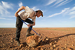 Guido Westhoff turning rocks in the desert looking for snakes taking shelter underground
