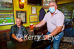 Enjoying a pint in the reopening of the Saddle Bar in Listowel on Monday, as Jimmy O'Connell gets served by Sean Costello.