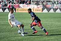 FOXBOROUGH, MA - MARCH 7: DeJuan Jones #24 of New England Revolution plays the ball behind Przemyslaw Frankowski #11 of Chicago Fire during a game between Chicago Fire and New England Revolution at Gillette Stadium on March 7, 2020 in Foxborough, Massachusetts.