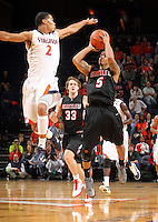 Dec. 22, 2010; Charlottesville, VA, USA; Seattle Redhawks guard Cervante Burrell (5) is defended by Virginia Cavaliers guard Mustapha Farrakhan (2) as he tries to make a shot during the game at the John Paul Jones Arena. Mandatory Credit: Andrew Shurtleff