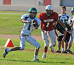 Football action. Wide receiver grabs a pass.