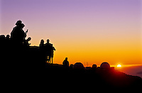 Sunset and Science City observatories at 10,000 feet in Haleakala National Park, Maui.