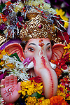MUMBAI, INDIA - SEPTEMBER 27, 2010: An idol of the Hindu elephant headed god Ganesh in Mumbai during the Ganpati Festival where millions throng to Mumbai's coastline to immerse the idols in the sea in an annual religious ceremony.The Taj Mahal Palace and Tower Hotel in Mumbai has re-opened after the terror attacks of 2008 destroyed much of the heritage wing. The wing has been renovated and the hotel is once again the shining jewel of Mumbai. pic Graham Crouch