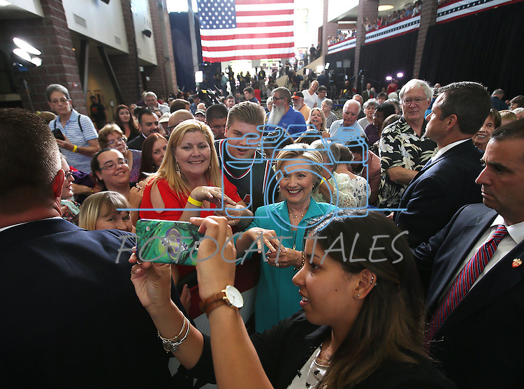 Western Nevada College Deaf Studies Professor Cindy Frank teaches Democratic presidential nominee Hillary Clinton some sign language during a campaign stop in Reno, Nev., on Thursday, Aug. 25, 2016. Cathleen Allison/Las Vegas Review-Journal