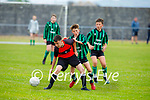 Tralee Dynamos Leon O'Sullivan under pressure from Conor McGirney of Fenit Samphires in the U14 cup competition.
