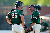 Greensboro Grasshoppers pitching coach Charlie Corbell #25 has a chat with pitcher Alejandro Ramos #23 at  L.P. Frans Stadium July 10, 2010, in Hickory, North Carolina.  Ramos would blow the save in the game eventually won by the Hickory Crawdads 7-6 in 11 innings.  Photo by Brian Westerholt / Four Seam Images