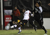 COLLEGE PARK, MD - NOVEMBER 25, 2012: Mikias Eticha (11) of the University of Maryland slips a pass away from Mikey Lightbourne (17) of Coastal Carolina University during an NCAA championship third round match at Ludwig Field, in College Park, MD, on November 25. Maryland won 5-1.
