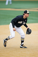 Wake Forest Demon Deacons third baseman Joe Napolitano (12) on defense against the Towson Tigers at Wake Forest Baseball Park on March 1, 2015 in Winston-Salem, North Carolina.  The Demon Deacons defeated the Tigers 15-8.  (Brian Westerholt/Four Seam Images)