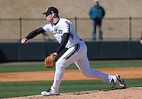 RHP Jack Quigley (44) of the Northwestern Wildcats pitches in a game against the Michigan State Spartans on Sunday, February 17, 2013, at Fluor Field at the West End in Greenville, South Carolina. Michigan State won, 7-4. (Tom Priddy/Four Seam Images)