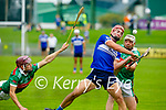 Fionan Mackessy of St Brendan's been hooked and blocked by Crotta's Shane Nolan and Donal Hunt in the County Senior Hurling Championship quarter final