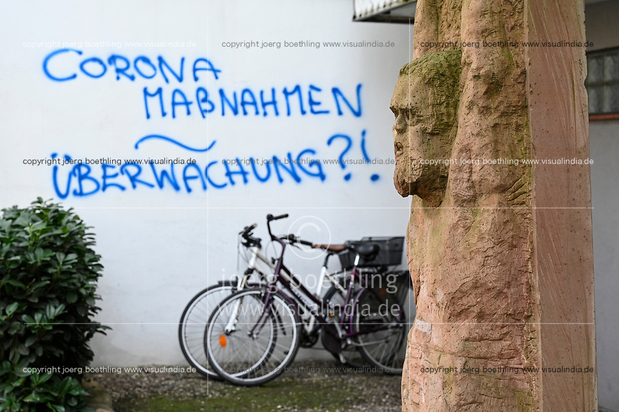 Germany, Hamburg, Corona crisis, graffiti , besprühte Hauswand mit der Frage: Corona Massnahmen - Ueberwachung ?