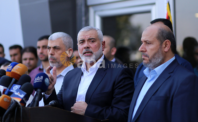 """Hamas Chief Ismail Haniyeh speaks to the press upon his arrival on the Palestinian side of the Rafah border crossing, in the southern Gaza Strip on September 19, 2017. Haniyeh said on Tuesday evening that his movement is ready to receive the Palestinian Unity Government in Gaza during a press conference held immediately after returning to the Gaza Strip from Cairo, he said: """"To show Hamas' seriousness to bring about reconciliation, we invite the unity government to come and assume its duties in Gaza unimpeded."""". Photo by Yasser Qudih"""