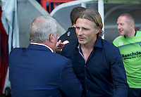 Manager Gareth Ainsworth (right) of Wycombe Wanderers greets Manager Dermot Drummy of Crawley Town during the Sky Bet League 2 match between Crawley Town and Wycombe Wanderers at Broadfield Stadium, Crawley, England on 6 August 2016. Photo by Alan  Stanford / PRiME Media Images.