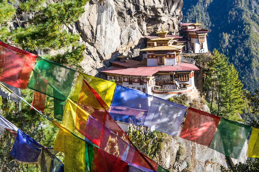 Paro, Bhutan.  Tiger's Nest Monastery, Prayer Flags in Foreground.