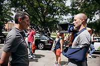Steve Cummings (GBR/Dimension Data) making the best of his time after an injury setback sustained in the Tour of the Basque Country by interviewing his former teammate, now trainer at BMC, Marco Pinotti for Eurosport at the stage start in Reggio Emilia<br /> <br /> 100th Giro d'Italia 2017<br /> Stage 13: Reggio Emilia › Tortona (167km)