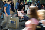 © Joel Goodman - 07973 332324 . 19/07/2016 . Manchester , UK . Environmental improvements to this area have been part funded by the European Union - a man sleeping on a bench on Market Street . Sunshine in Manchester City Centre on the hottest day of the year so far . Photo credit : Joel Goodman