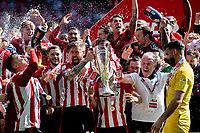 Pontus Jansson of Brentford lifts the trophy at the full time whistle of the Sky Bet Championship Play Off Final match between Brentford and Swansea City at Wembley Stadium in London, England, UK. Saturday 29 May 2021