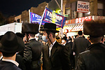 Residents gather to protest against COVID-19 restrictions in the Orthodox Jewish neighborhood Borough Park on Wednesday, October 7, 2020 in the Park in the Brooklyn borough of New York City.  Residents are protesting against new restrictions that would close schools, limit attendance at religious services and close non-essential businesses in areas with surges in COVID-19 cases.  Photograph by Michael Nagle