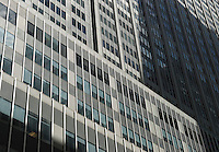 Available from Jeff for Editorial Licensing.<br /> <br /> Office Building Facade in Shadow, Midtown Manhattan, New York City, New York State, USA