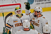 29 December 2018: University of Vermont Catamount Goaltender Stefanos Lekkas, a Junior from Elburn, IL, celebrates with Defenseman Matt O'Donnell, a Junior from Fountain Valley, CA, after a game against the Rensselaer Engineers at Gutterson Fieldhouse in Burlington, Vermont. The Catamounts rallied from a 2-0 deficit to defeat RPI 4-2 and win the annual Catamount Cup Tournament. Mandatory Credit: Ed Wolfstein Photo *** RAW (NEF) Image File Available ***