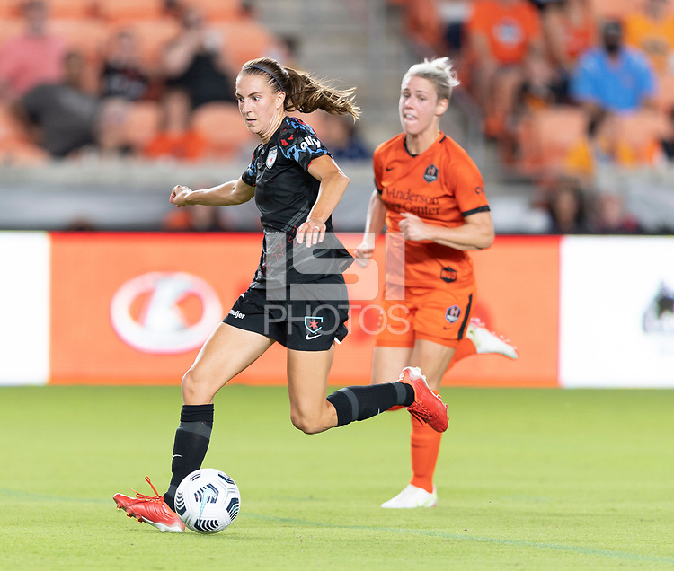 HOUSTON, TX - SEPTEMBER 10: Sarah Woldmoe #16 of the Chicago Red Stars brings the ball up the field during a game between Chicago Red Stars and Houston Dash at BBVA Stadium on September 10, 2021 in Houston, Texas.