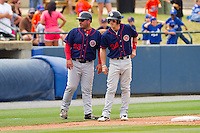 Hagerstown Suns manager Brian Daubach #23 talks to Bryce Harper #34 at third base during the game against the Rome Braves at State Mutual Stadium on May 1, 2011 in Rome, Georgia.   Photo by Brian Westerholt / Four Seam Images