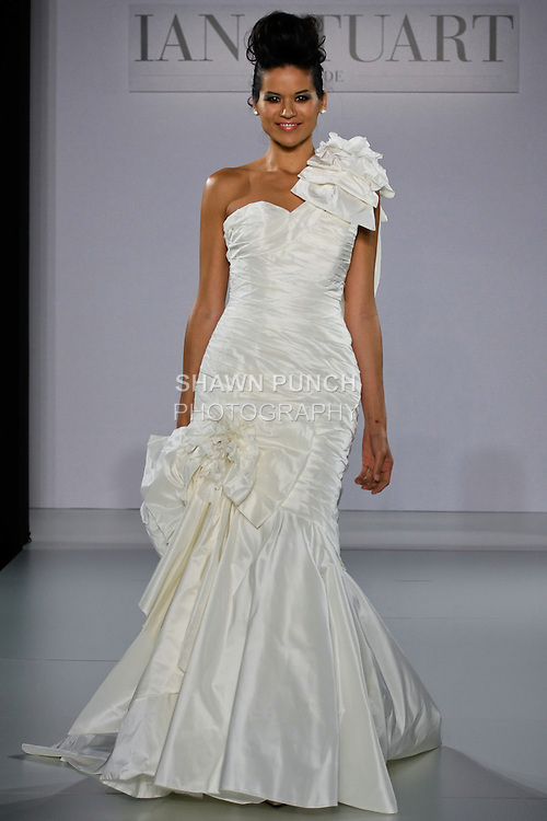 Model walks runway in a Passion Flower wedding dress from the Ian Stuart - Supernova Bridal Collection 2013 fashion show, at the Couture Show during New York Bridal Fashion Week, October 14, 2012.