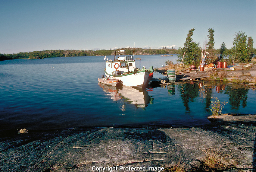 Commercial fishing boat at camp for the evening at Wool Bay on Great Slave lake.