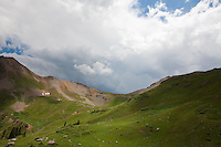To me, this epitomizes summer in the Colorado high country - lush green mountainsides, a few hardy trees stubbornly reaching above timberline, and an afternoon storm building over the next ridge<br /> <br /> Canon EOS 5D, 24mm f/2.8 lens