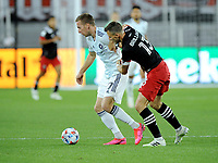 WASHINGTON, DC - MAY 13: Robert Beric #27 of Chicago Fire battles for the ball with Frederic Brilliant #13 of D.C. United during a game between Chicago Fire FC and D.C. United at Audi FIeld on May 13, 2021 in Washington, DC.