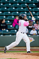 Courtney Hawkins (10) of the Winston-Salem Dash grimaces after swinging at a pitch out of the strike zone during the game against the Wilmington Blue Rocks at BB&T Ballpark on April 20, 2013 in Winston-Salem, North Carolina.  The Dash defeated the Blue Rocks 4-2 in game one of a double-header.  (Brian Westerholt/Four Seam Images)