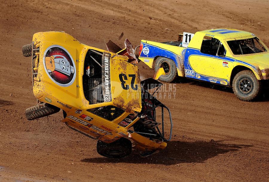 Apr 17, 2010; Surprise, AZ USA; LOORRS pro light unlimited driver Jerry Daugherty (23) flips over during round 3 at Speedworld Off Road Park. Mandatory Credit: Mark J. Rebilas-US PRESSWIRE.