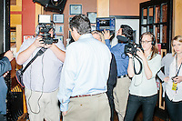 Texas senator and Republican presidential candidate Ted Cruz speak to the media after a business round-table at the Draft Sports Bar and Grille in Concord, New Hampshire.