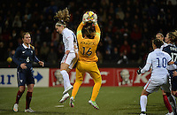 Lorient, France. - Sunday, February 8, 2015:  Morgan Brian (15) of the USWNT and goalkeeper Sarah Bouhaddi (16) of France. France defeated the USWNT 2-0 during an international friendly at the Stade du Moustoir.