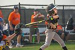 Little League baseball player swinging bat.